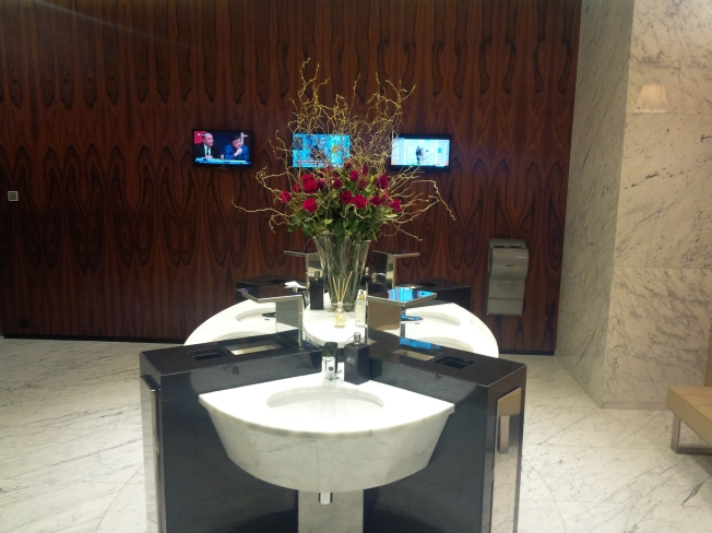 A bouquet of roses in the men's washroom!