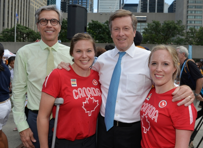 Toronto, ON - Aug 4 2015 - Canadian Paralympic Committee Gaétan Tardif, Assistant Chef de Mission Stephanie Dixon, Toronto Mayor John Tory and Chef de Mission Elizabeth Walker-Young at the volunteer recognition event at Nathan Phillips Square (Photo: Matthew Murnaghan/Canadian Paralympic Committee)